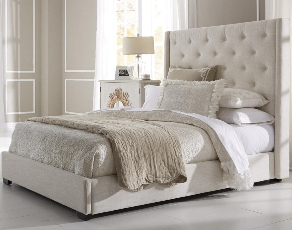 good bedroom with upholstered headboard and cushions also bedside table