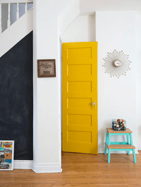 interior room with spicy mustard yellow door also laminate wood flooring