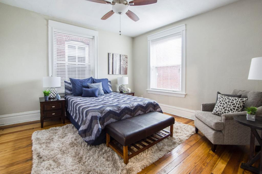 Decorate a Small Master bedroom with rug and stylish bedside lamps