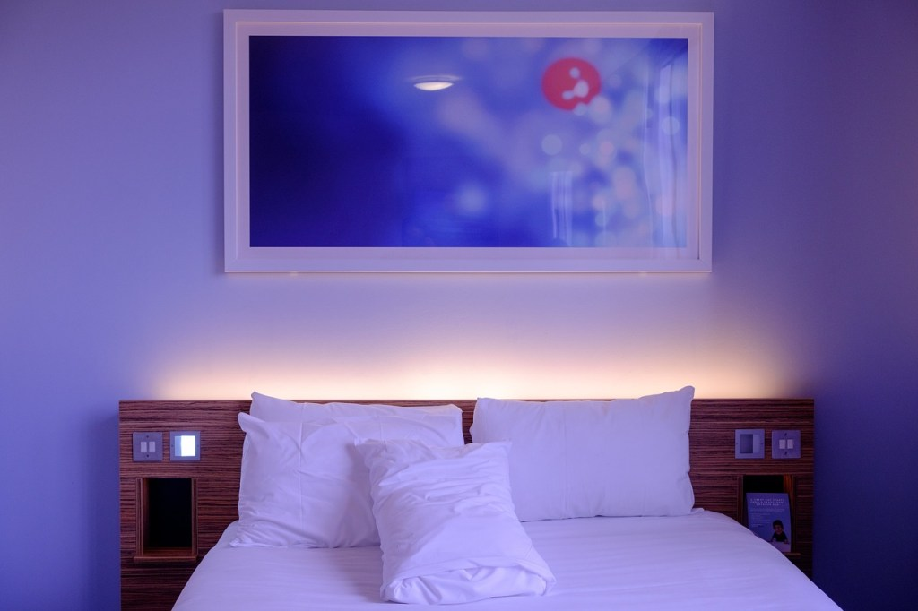 decorate bedroom with hidden lighting and wall art