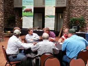 Dr. Williams deep in conversation at the Grassfed Exchange.
