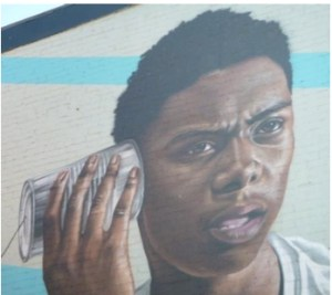 young man with tin can telephone