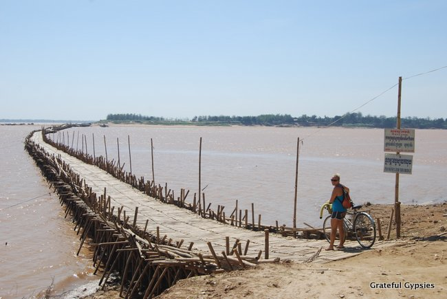 Crossing the bamboo bridge in Kampong Cham.