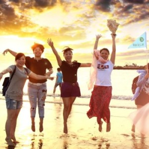 Girls jumping joyfully on a beach