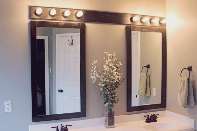 wooden light fixture over bathroom