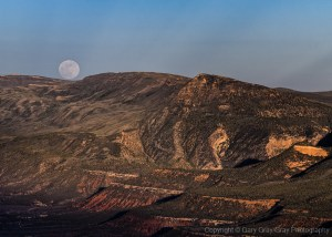 Full moon rising above echo park in Dinasaur National Monument