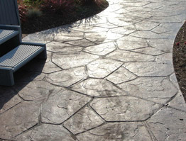 stamped concrete vs patio pavers the