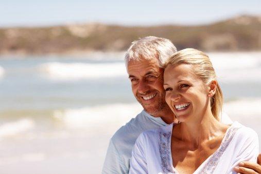 Happy mature couple enjoying at beach