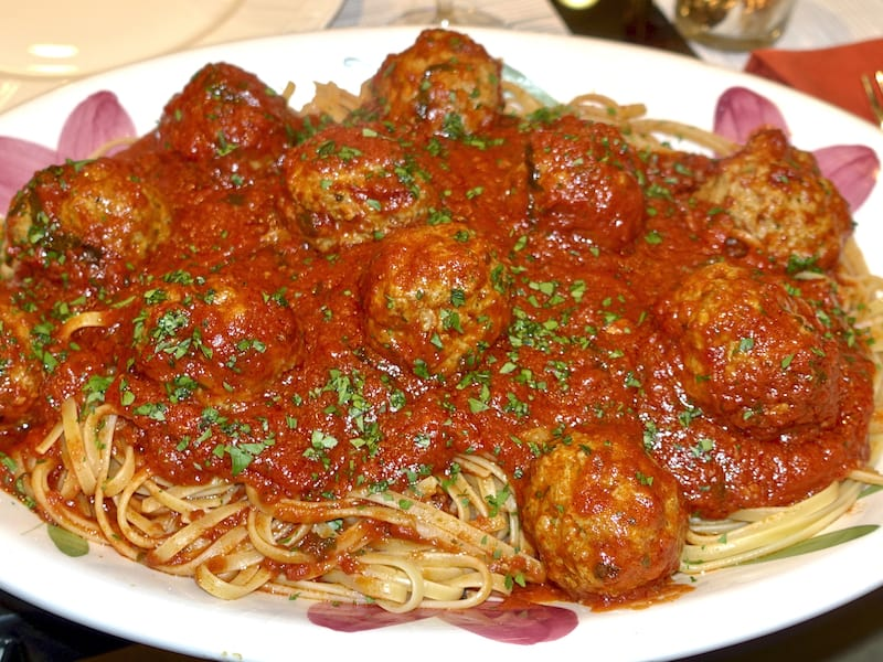 A platter of spaghetti and meatballs.