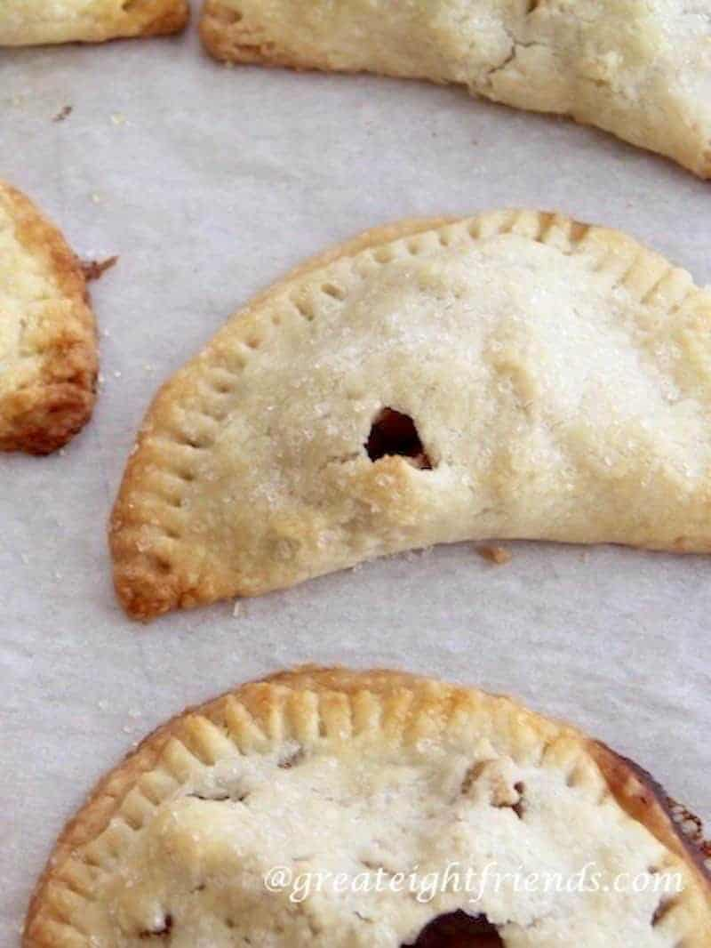 The perfect snack or dessert, Fruit Hand Pies. These little pockets filled with fruit are delicious served warm with ice cream or cold as a snack.