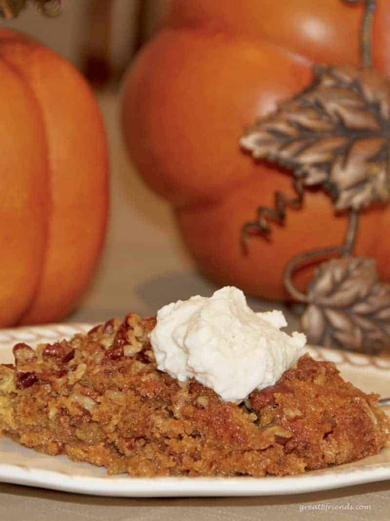 This Pumpkin Pie Crunch Dessert is so easy to make, so delicious and the perfect addition to a potluck, holiday dinner or any meal!