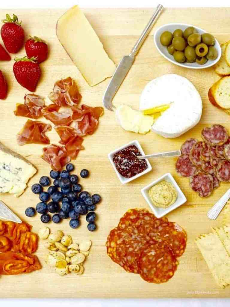 A Cheese and Charcuterie Board served with nuts and fruit