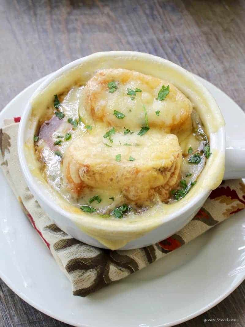 French Onion Soup topped with bread and melted cheese.