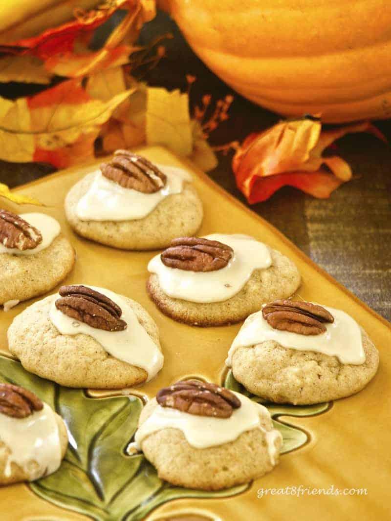 Pumpkin Cookies with Pecan halves on top.