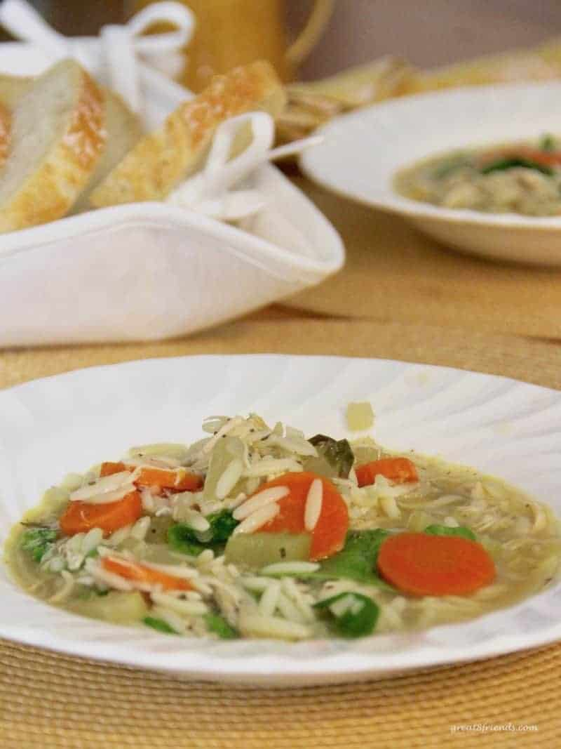 Low white bowl of Lemony Chicken Orzo Soup.
