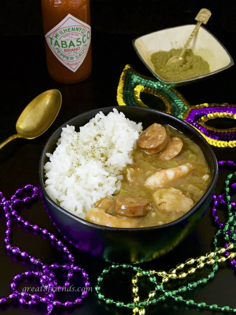 Sausage Shrimp and Chicken Gumbo with rice, Tabasco, Filet powder, and Mardi Gras beads