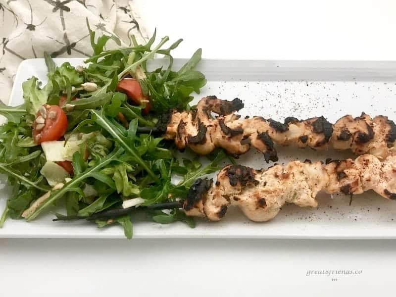 Middle East Grilled Lemon Yogurt Chicken skewers served with an arugula salad