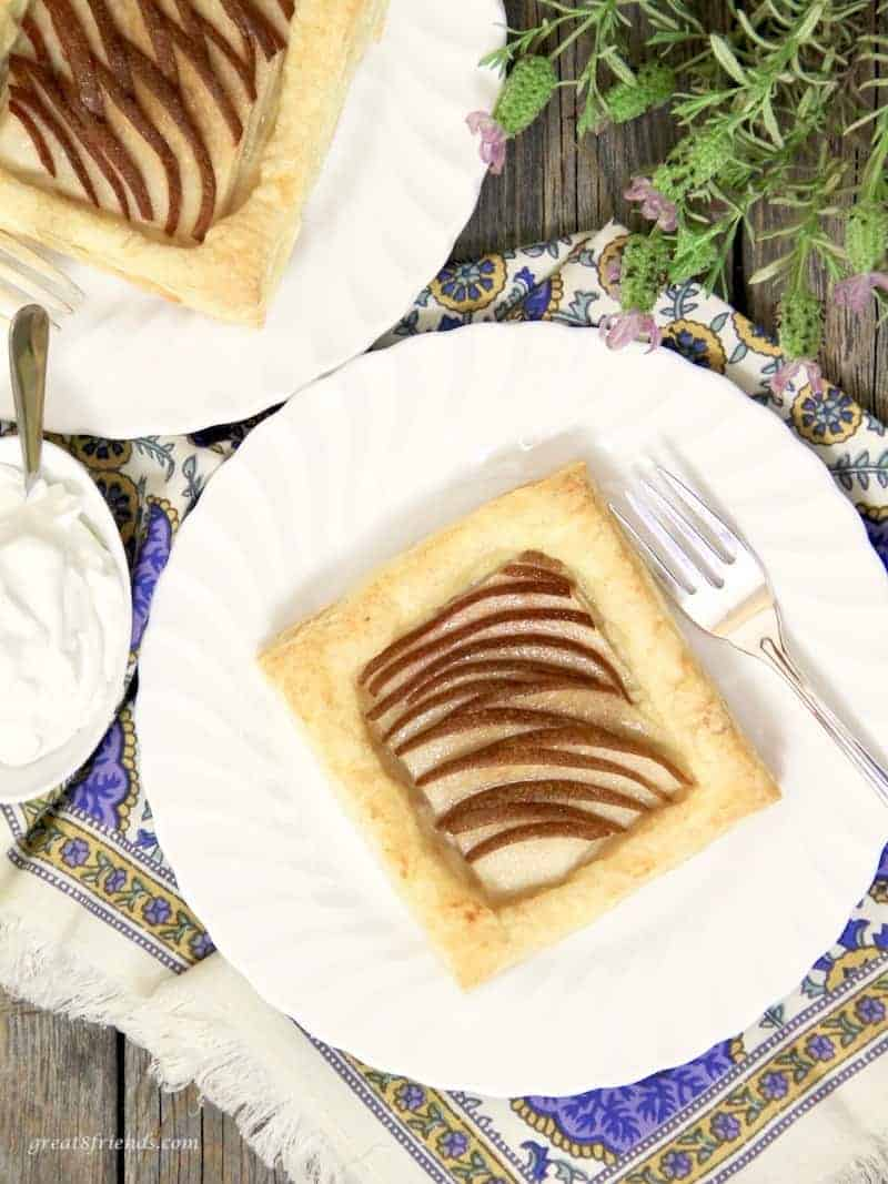 Individual puff pastry pear tarts served with whipped cream