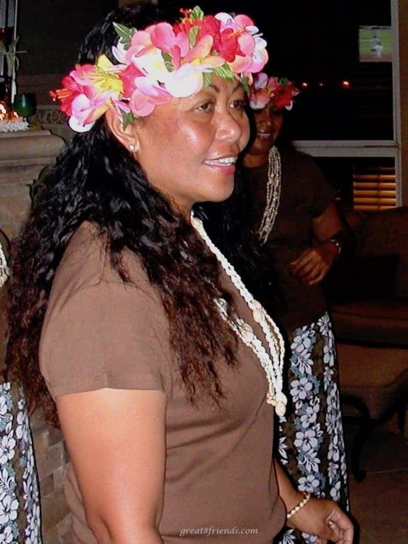 Hawaiian hula instructor with a lei around her head.