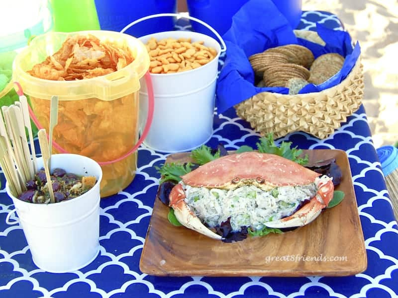 Appetizers, olives, chips, goldfish, crackers and crab salad.
