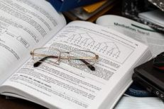 eyeglass and book