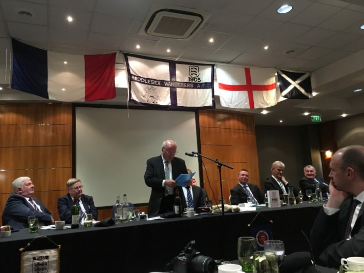 FA Chairman, Greg Dyke, speaking at the Middlesex Wanderers AFC with French flag, St George's Flag, Scottish flag hanging above him
