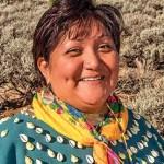 Indigenous woman, Regina Lopez-Whiteskunk, wearing traditional clothing