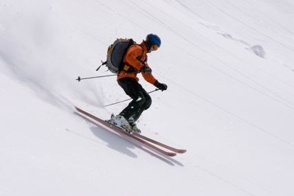 A skier down the slope