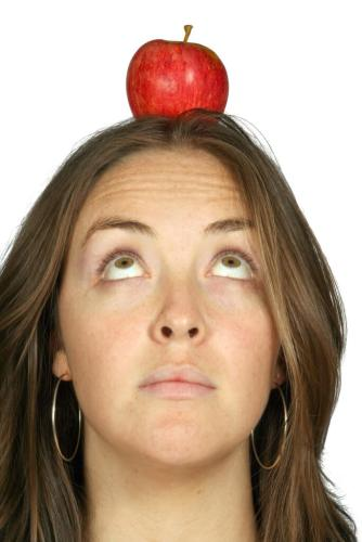 beautiful girl with an apple on her head