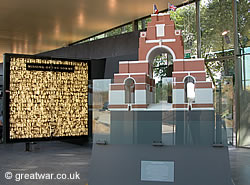Inside the Thiepval Visitor Centre, with (left) the photographic panel of 600 of the Missing of the Somme and (right) Lutyens' scale model for the memorial.