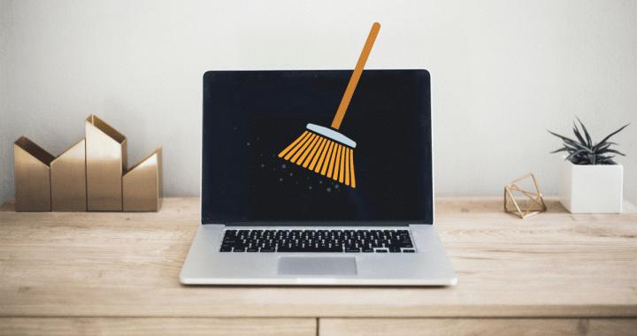 Immagine computer Apple Mac emblematica con scopa che pulisce spazio.