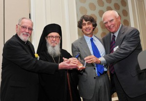 Archbishop Demetrios and Charles H. Cotros, joined by Fr. Eugene Pappas, far left, present Archbishop Iakovos Leadership 100 Award for Excellence to Alexander Payne, second from right; Charles H. Cotros and Archbishop Demetrios present Archbishop Iakovos Leadership 100.