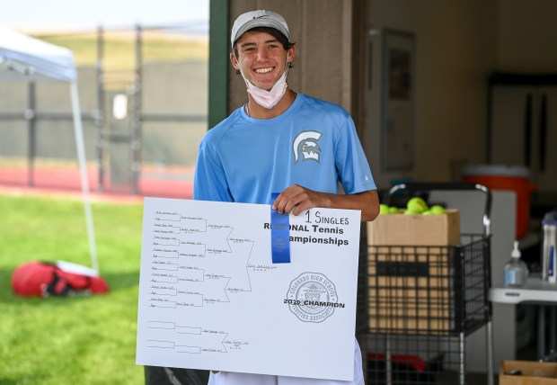 GREELEY, CO - SEPTEMBER 18:Greeley West's Nico Jamison stands with his bracket and ribbon after taking first place in the region for #1 singles during the class 4A region 4 boys tennis tournament at Centennial Courts in Greeley Sept. 18, 2020. Greeley West took second place in the team competition. (Alex McIntyre/Staff Photographer)