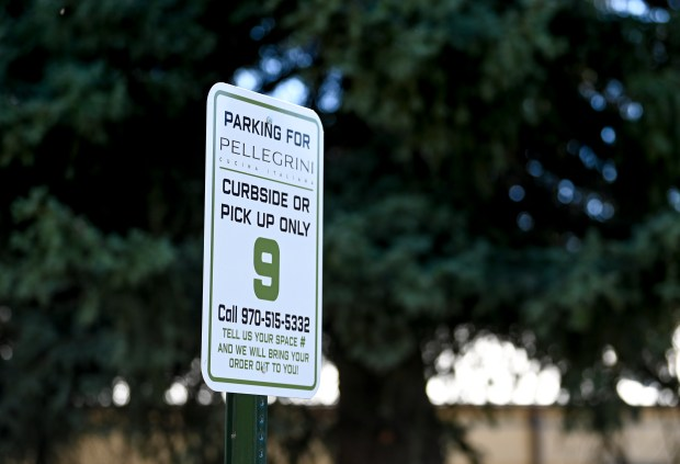 GREELEY, CO - SEPTEMBER 01:A curbside pickup sign stands outside at the partially-rebuilt Pellegrini Cucina Italiana in Greeley Sept. 1, 2020. After a fire in March 2019, Pellegrini has rebuilt enough of the restaurant to offer takeout and catering services and hopes to reopen the dining room next year. (Alex McIntyre/Staff Photographer)