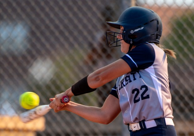 GREELEY, CO - SEPTEMBER 03:University's Ashlyn Knapp (22) makes contact during a softball game between the University Bulldogs and the Sterling Tigers at Twin Rivers Ball Fields in Greeley Sept. 3, 2020. The Tigers defeated the Bulldogs 6-4. (Alex McIntyre/Staff Photographer)