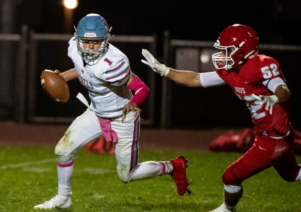 EATON, CO - OCTOBER 09:Weld Central's Tinaiden Thompson (1) tries to avoid the sack as Eaton's Jacob Webster (52) closes in during the Eaton Reds football season opener against the Weld Central Rebels at Eaton High School in Eaton Oct. 9, 2020. The Reds defeated the Rebels 49-6. (Alex McIntyre/Staff Photographer)