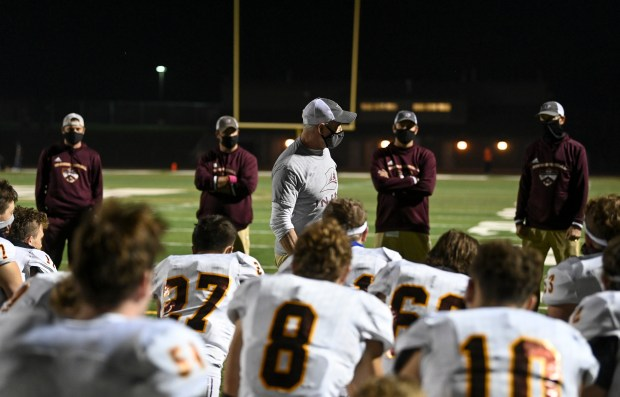 GREELEY, CO - OCTOBER 08:Windsor head coach Chris Jones, center, speaks with his team after the Greeley Central Wildcats home opener against the Windsor Wizards at District 6 Stadium in Greeley Oct. 8, 2020. The Wildcats fell to the Wizards 51-8. (Alex McIntyre/Staff Photographer)