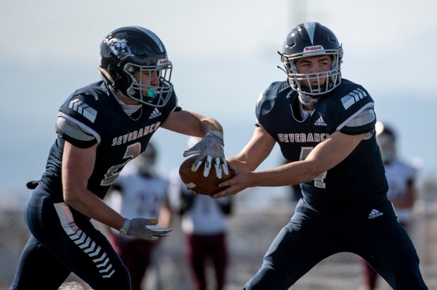 SEVERANCE, CO - OCTOBER 31:Severance's Nolan Hertzke (4) makes a hand off to Severance's Jake Shorb (2) during the Severance Silver Knights football game against the Berthoud Spartans at Severance High School in Severance Oct. 31, 2020. The Silver Knights defeated the Spartans 42-6. (Alex McIntyre/Staff Photographer)