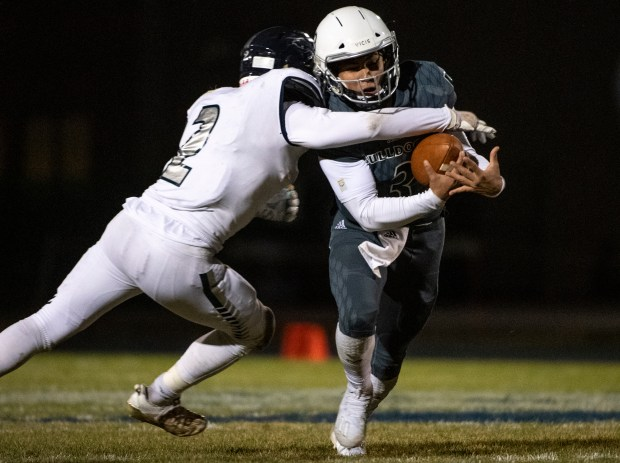 GREELEY, CO - OCTOBER 22:Severance's Jake Shorb (2) wraps up University's Greg Garza (3) during the Severance Silver Knights game against the University Bulldogs at Tom Roche Field at University High School in Greeley Oct. 22, 2020. The Bulldogs took down the Silver Knights 26-14. (Alex McIntyre/Staff Photographer)
