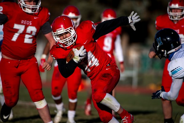 EATON, CO - NOVEMBER 14:Eaton's Salvador Rojas (14) runs during the Eaton Reds football regular season finale against the Platte Valley Broncos at Eaton High School in Eaton Nov. 14, 2020. The Platte Valley Broncos defeated the Eaton Reds 41-35. (Alex McIntyre/Staff Photographer)