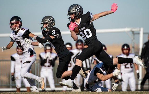 JOHNSTOWN, CO - NOVEMBER 21:Roosevelt's Tucker Peterson (20) runs on a kick return during the top-seeded Roosevelt Rough Riders first round playoff game against the No. 8 Fort Morgan Mustangs at Peterson Field at Roosevelt High School in Johnstown Nov. 21, 2020. The Roosevelt Rough Riders took down the Fort Morgan Mustangs 17-16 with a final-seconds field goal to advance to the CHSAA Class 3A State Semifinal next week. (Alex McIntyre/Staff Photographer)