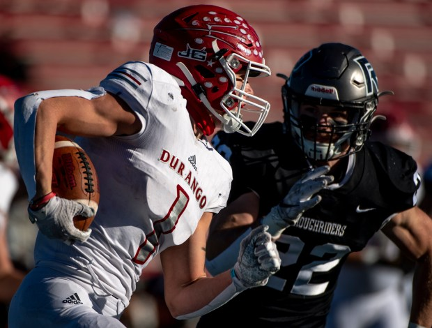 PUEBLO, CO - DECEMBER 05:Roosevelt's Cooper Walton (22) closes in on Durango's Ben Finneseth (1) during the Roosevelt Rough Riders game against the Durango Demons in the CHSAA Class 3A football state championship at the Neta and Eddie DeRose ThunderBowl at Colorado State University-Pueblo in Pueblo Dec. 5, 2020. The Roosevelt Rough Riders fell to the Durango Demons 21-14. (Alex McIntyre/Staff Photographer)