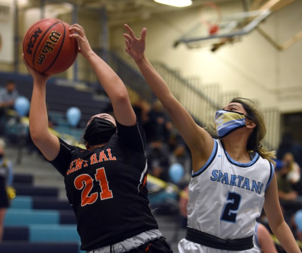 Greeley Central's Kim Arredondo grabs a rebound away as Greeley West's Jasmine Johnson tries to block her during the game Monday night at Greeley West High School. (For the Greeley Tribune/Joshua Polson)