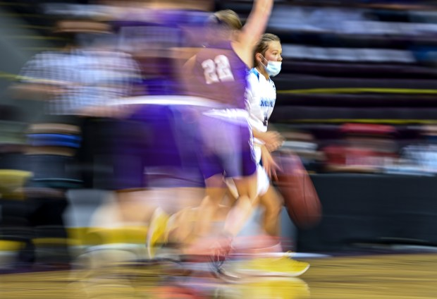 COLORADO SPRINGS, CO - MARCH 20:Platte Valley's Cora Schissler (2) tries to find her way around Lutheran's Joclyn Bassett (22) during the Platte Valley Broncos 3A state championship girls basketball game against the Lutheran Lions at the Broadmoor World Arena in Colorado Springs March 20, 2021. The Platte Valley Broncos defeated the Lutheran Lions 51-44 to take the 3A state title. (Alex McIntyre/Staff Photographer)