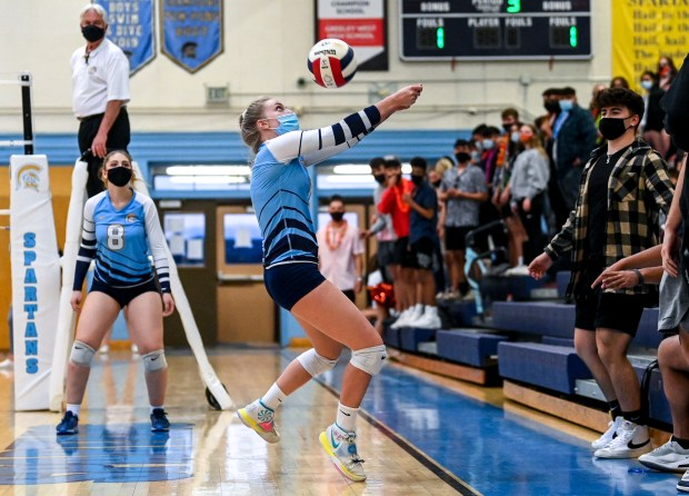GREELEY, CO - APRIL 08:Greeley West's Morgan Schenck (1) digs as the ball flies toward the Greeley West student section during the Greeley Central Wildcats rivalry volleyball game against the Greeley West Spartans at Greeley West High School in Greeley April 8, 2021. The Spartans defeated their crosstown rivals 3-1. (Alex McIntyre/Staff Photographer)