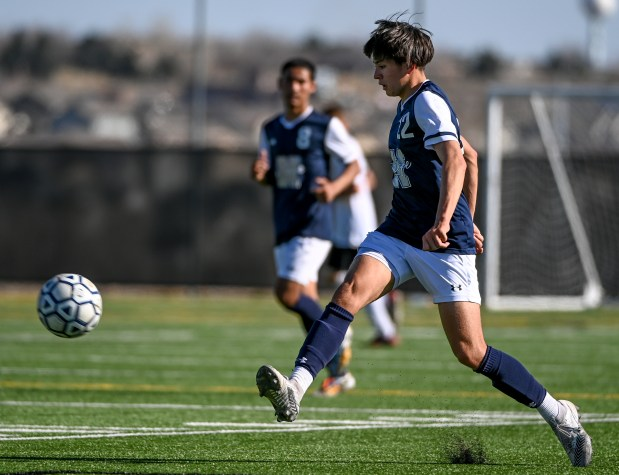 GREELEY, CO - APRIL 03:Northridge's Justus Alcala (22) drives down the pitch during the Northridge Grizzlies boys soccer match against the Roosevelt Rough Riders at District 6 Soccer Stadium in Greeley April 3, 2021. (Alex McIntyre/Staff Photographer)