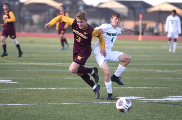 AURORA, CO - APRIL 28:Windsor's John Burnett tries to beat Niwot's Jacob Elston to the ball during the Windsor Wizards 4A boys soccer semifinal match against the Niwot Cougars at Legacy Stadium in Aurora April 28, 2021. The Wizards defeated the Cougars 2-1 and will advance to the state championship match on Saturday. (Joshua Polson for the Greeley Tribune)