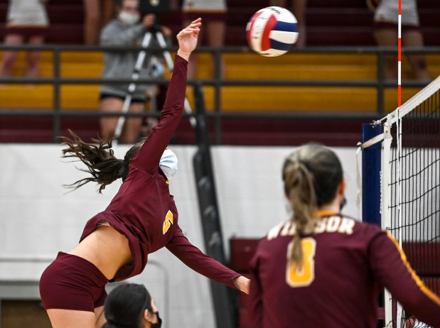 WINDSOR, CO - APRIL 14:Windsor's Avery Lacy (5) attacks during the Windsor Wizards volleyball match against the Riverdale Ridge Ravens at Windsor High School in Windsor April 14, 2021. The Wizards defeated the Ravens in 3 sets.(Alex McIntyre/Staff Photographer)