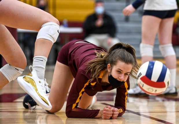 WINDSOR, CO - APRIL 14:Windsor's Julia Bohlinger (6) grimaces as she dives but can't make it for the dig during the Windsor Wizards volleyball match against the Riverdale Ridge Ravens at Windsor High School in Windsor April 14, 2021. The Wizards defeated the Ravens in 3 sets.(Alex McIntyre/Staff Photographer)
