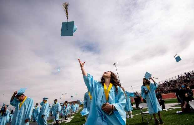 GREELEY, CO - MAY 22:New graduates, including Allie Renouf, center, toss their caps into the air during the Greeley West High School Class of 2021 Commencement Ceremony at District 6 Stadium in Greeley May 22, 2021. (Alex McIntyre/Staff Photographer)